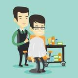 Barber making haircut to young asian man. Stock Photo