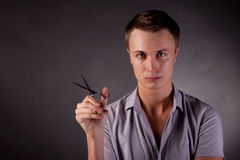 The barber man. Scissors, comb. Royalty Free Stock Image