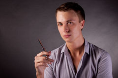 The barber man. Scissors, comb. Royalty Free Stock Photos