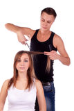 The barber man and a woman client Stock Photography