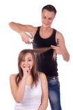 The barber man and a woman client Royalty Free Stock Image