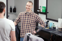 Barber meets a male client Stock Photos