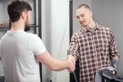 Barber meets a male client Stock Image