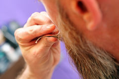 Barber modeling beard and mustache shapes Royalty Free Stock Photo