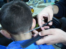 Barber,the parofession of a barbar. Craftsmanship Stock Image