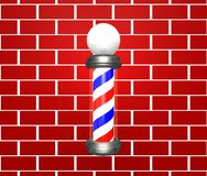 Barber Pole. On a brick wall Stock Image