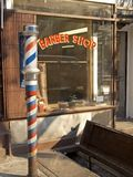 Barber Pole. This is a shot of an old fashioned barber shop store front Stock Photo