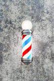 Barber pole. On concrete wall Royalty Free Stock Photography