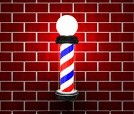 Barber pole on a wall. Barber pole on a brick wall Stock Image