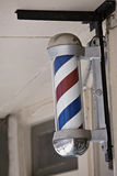 Barber pole on wall Stock Photo