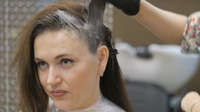 Barber. Professional hair coloring a hairdresser. stock footage