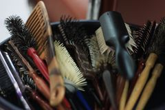 Barber`s combs tools in a salon royalty free stock photo