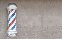 Barber's pole. With wall space for background Royalty Free Stock Photo