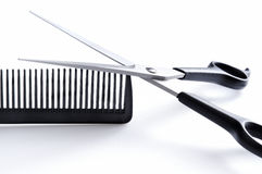 Barber scissors and comb closeup front view Royalty Free Stock Photo