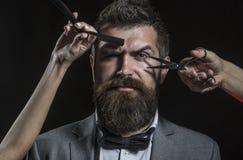Barber scissors and straight razor, barbershop. Mens haircut, shaving. Bearded man, long beard, brutal, caucasian. Hipster with moustache. Vintage barbershop stock image
