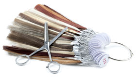 Barber scissors and strands of hair Stock Images