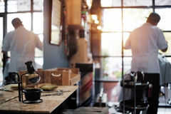Barber selective focus and blur background barber hair cut. stock image