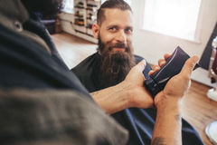 Barber serving client at his shop stock photos