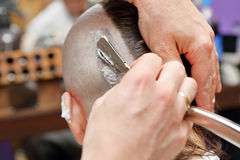 Barber shave and modeling alternative hairdo Royalty Free Stock Photography