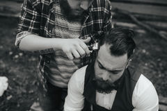 Barber shaves a bearded man Royalty Free Stock Images