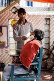 Barber shaving man in Delhi Stock Photo