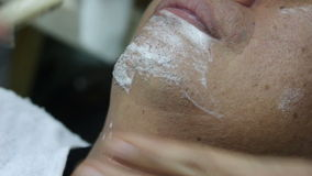 Barber Shaving a man skin stock video footage