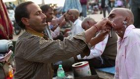 Barber shaving a pilgrim stock footage