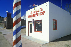 Barber Shop with barber pole. Lloyd's Barber shop with barber pole in foreground, Lyons, Colorado Stock Images