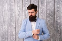 Barber shop concept. Beard and mustache. Guy well groomed handsome bearded hipster wear tuxedo. Romantic wedding outfit royalty free stock photography
