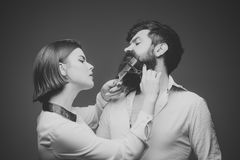 Barber shop. Hair style. Barbershop or hairdresser concept. Woman hairdresser cuts beard with scissors. Man with long royalty free stock images