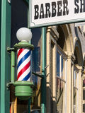 Barber Shop pole and sign. Barber shop pole. Red, white and blue barber pole Stock Images