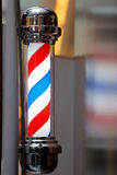 Barber shop vintage pole on blurred background Royalty Free Stock Image