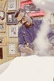 Barber steaming a beard Stock Photos