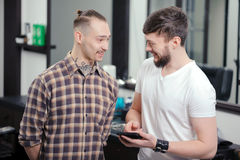Barber talks to a client royalty free stock photos
