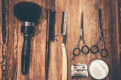 Barber tools. Top view of barbershop tools lying on the wood grain Stock Images