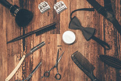 Barber tools. Top view of barbershop tools and men accessories lying on the wood grain Stock Photography