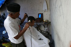 Barber. Was cutting hair a citizen in Sukoharjo, Central Java, Indonesia Stock Photography