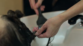 Barber washes the girl`s hair in a barbershop. stock video