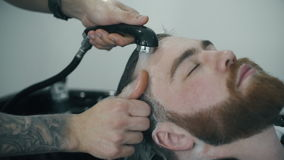 Barber washing man head stock video footage