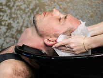 Barber washing man's head Stock Image