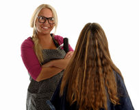 Barber woman and girl with long hair sits back Stock Photos
