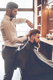 Barber at work. royalty free stock images