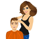 Barber working cutting long hair Royalty Free Stock Images