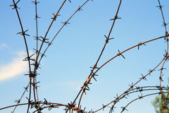 Barbered wire. Over a blue sky Stock Photography