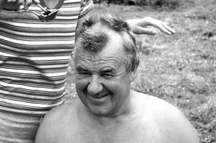 Barbering man. Barbering old man in the country side Royalty Free Stock Image