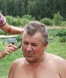Barbering men. Funny senior , barbering in country size Royalty Free Stock Images