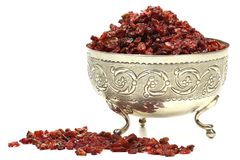 Barberries. Dried barberries in a silver bowl isolated on white background Stock Images