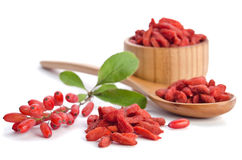Barberries and goji berries on white background Stock Photos