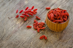Barberries and goji berries on wooden background Stock Image