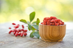 Barberries and goji berries. On wooden table Stock Images